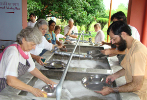 Devotees washing dishes