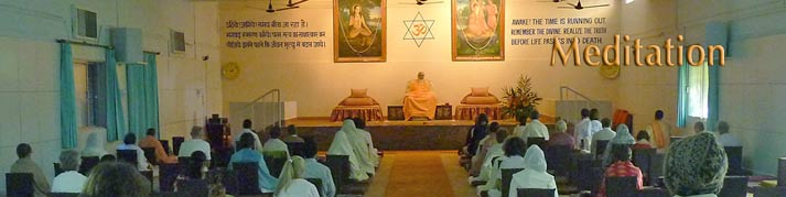 Swamiji and devotees sitting in meditation