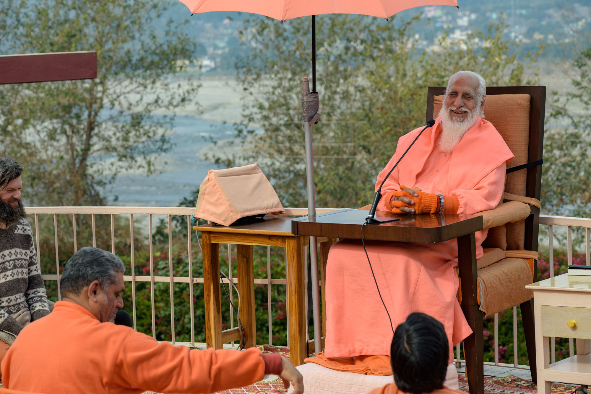 View of Swamiji during Satsang with Yamuna River in the background